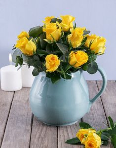 Yellow Roses in Water Jug_R539.95_Netflorist