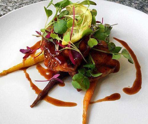 Grilled Pork Sirloin Steak on a bed of honey glazed rainbow carrots